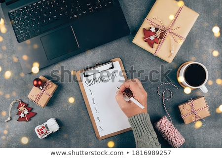 Girl orders Christmas gifts in a online shop Stock photo © alphaspirit