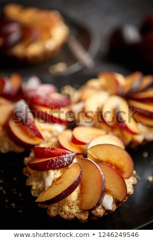 Delicious homemade mini tarts with fresh sliced plum fruit Stock photo © dash