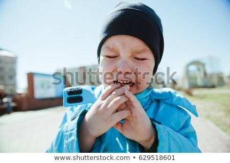 child is crying in the Winter, little boy, crying, upset. Stock photo © Lopolo