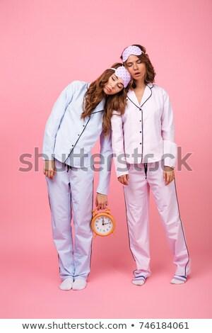 Kettő lányok visel pizsama áll izolált Stock fotó © deandrobot