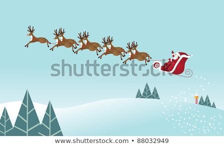 santa riding sleigh outdoor stock photo © colematt
