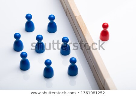 Red And Blue Figurine Pawn Separated By Wooden Blocks Stock photo © AndreyPopov