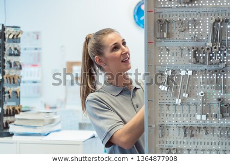 Women key maker in her shop  Stock photo © Kzenon
