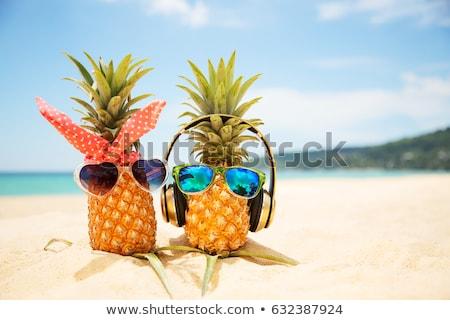 パイナップル ヘッドホン サングラス 砂 ビーチ クローズアップ ストックフォト © AndreyPopov