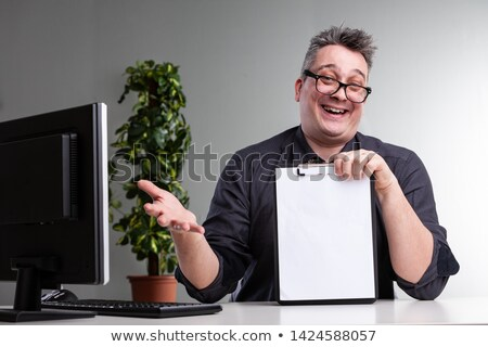 Laughing gleeful businessman gesturing Stock photo © Giulio_Fornasar