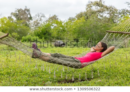 Ecotourism Travel on Galapagos - tourist relaxing in hammock by Giant Tortoise Stock photo © Maridav