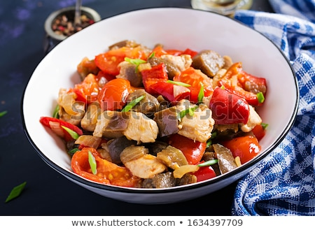 Stock photo: Sauteed or stewed eggplant with tomato