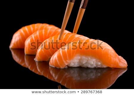 Somon sushi Çin yemek çubukları taş tahta gıda Stok fotoğraf © OleksandrO