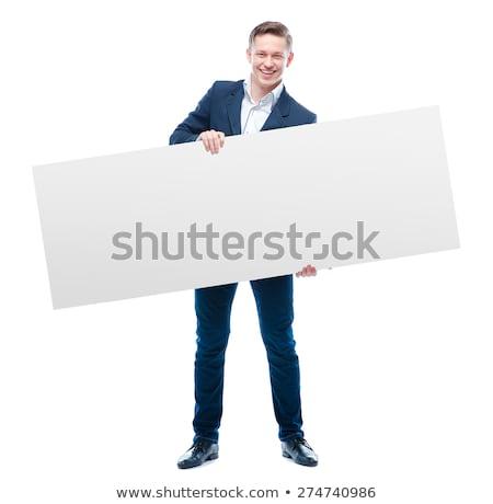 happy business man holding blank card in office stock photo © wavebreak_media