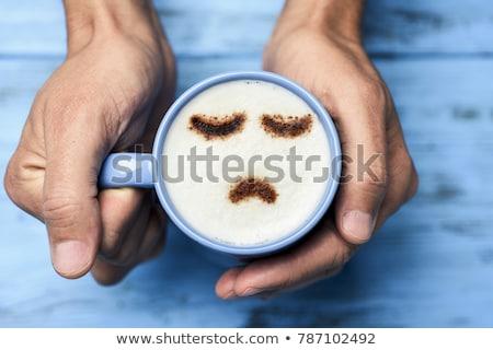 Férfi csésze cappucchino szomorú arc közelkép Stock fotó © nito