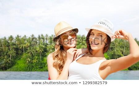 happy woman over infinity edge pool in sri lanka Stock photo © dolgachov