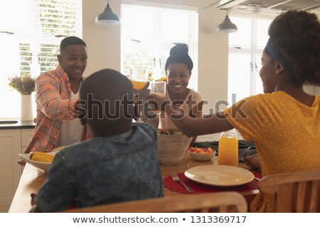 Rear view of happy African American family toasting glasses at dining table in a comfortable home Stock photo © wavebreak_media