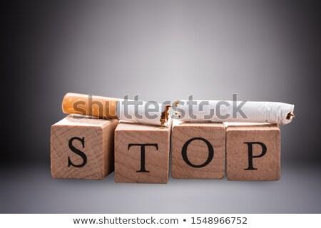 Broken Cigarette Over The Stop Wooden Block Stock photo © AndreyPopov