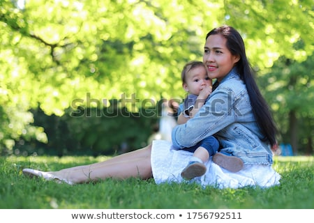 Baby girl with cute smile with mother having fun in public Park Stock photo © ElenaBatkova