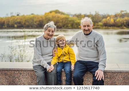 Senior couple with baby grandson in the autumn park. Great-grandmother, great-grandfather and great- Stock photo © galitskaya