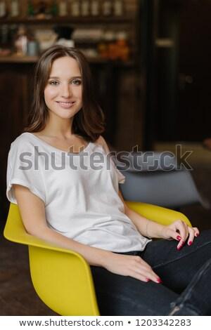 Függőleges lövés mosolygó nő sötét haj mosoly fogakkal fehér Stock fotó © vkstudio
