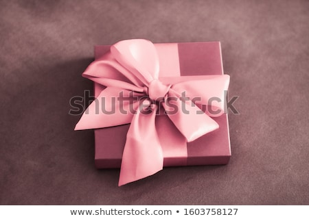 Vintage luxury holiday blush pink gift box with silk ribbon and  Stock photo © Anneleven