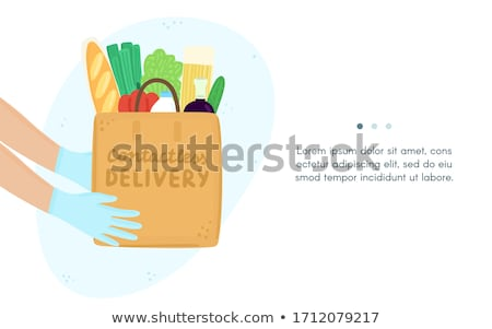 Contactless express safe delivery service. Grocery products bag in gloved hands Stock photo © user_10144511