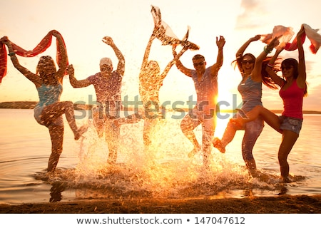 Group of young people enjoy summer  party at the beach Stock photo © dotshock