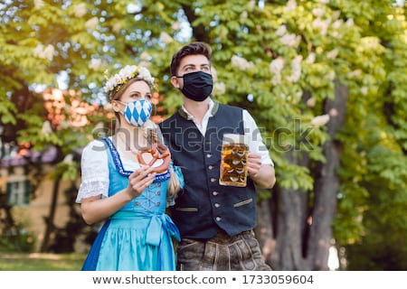 Bavarian couple during the coronavirus crisis Stock photo © Kzenon