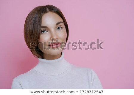 Portrait of good looking young woman with dark hair, minimal makeup, wears casual white turtleneck,  Stock photo © vkstudio