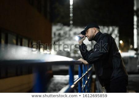Biztonsági őr éjszaka elemlámpa bent épület ajtó Stock fotó © AndreyPopov