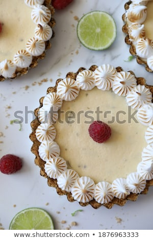 Mini lime curd tartlets with meringue. Stock photo © Melnyk