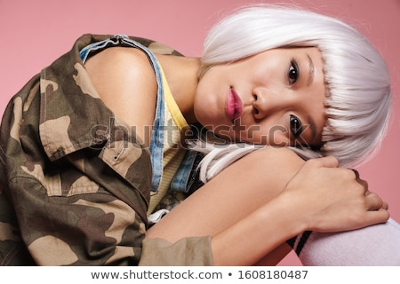 Image of young asian girl wearing white wig sitting with head on Stock photo © deandrobot