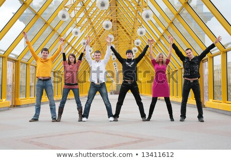 group of friends it stand  taking hands and rising them on footbridge Stock photo © Paha_L
