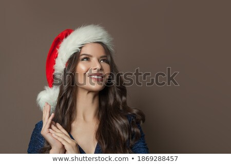 Beige Christmas background with brunette Stock photo © nurrka
