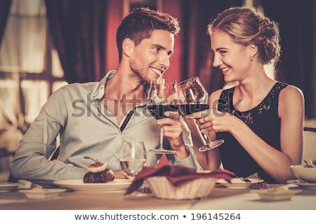 друзей · питьевой · вино · счастливым · улыбаясь - Сток-фото © photography33