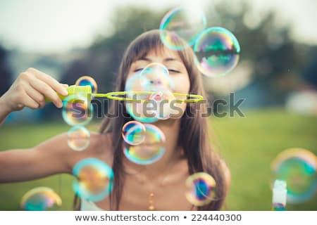 Könnyű buborékfújás káprázatos fiatal barna hajú nő Stock fotó © lithian