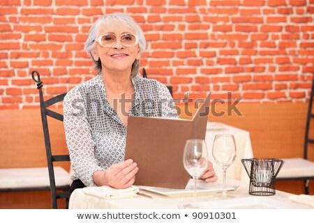 Idősebb nő étterem menü munka technológia Stock fotó © photography33