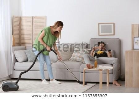 ленивый человека смотрят жена вакуум улыбка Сток-фото © photography33