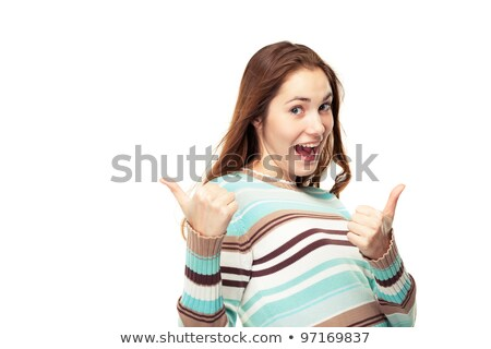Happy young woman showing double thumbs-up Stock photo © stockyimages
