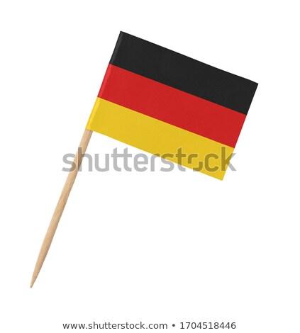 Miniatur Flagge Deutschland isoliert Sitzung Stock foto © bosphorus