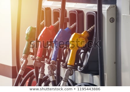 Gas pump nozzles in a service station Stock photo © Nobilior