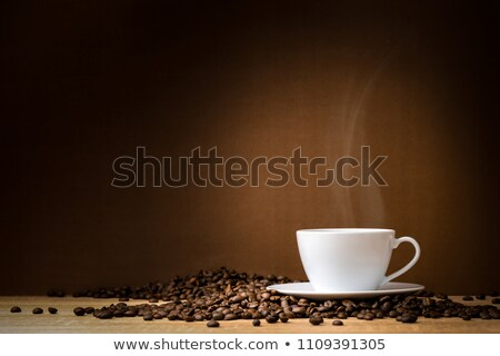 Coffee Beans In The Mug Representing Fresh Brewed Coffee Stock photo © stuartmiles
