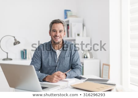 smiling relaxed architect looking at plans stock photo © photography33