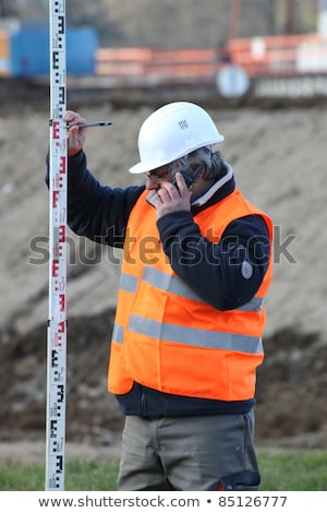 Civil engineer holding an elevation rod Stock photo © photography33