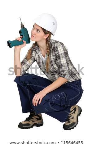 Handywoman crouching with drill Stock photo © photography33