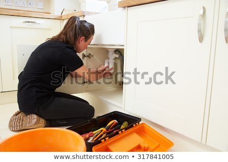 Female plumber installing a sink Stock photo © photography33
