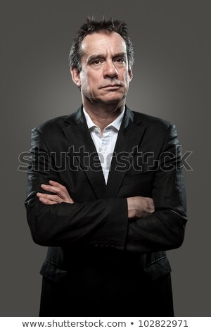 Grumpy Stern Business Man in Suit High Contrast Look stock photo © scheriton