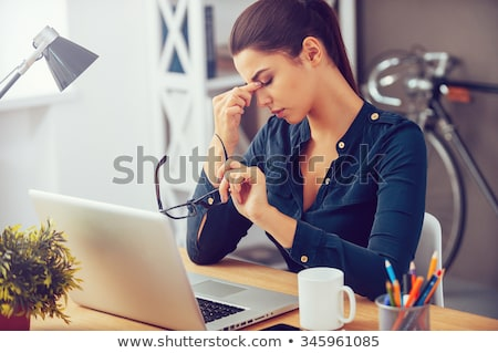 woman tired of working on her laptop Stock photo © photography33