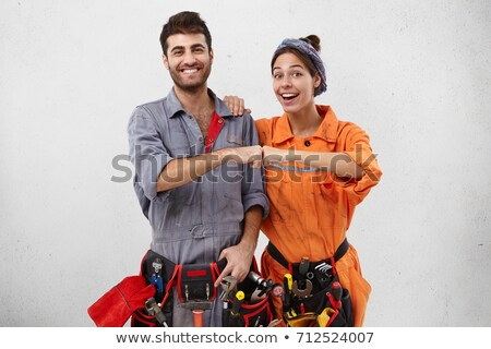 An ecstatic female construction worker. Stock photo © photography33