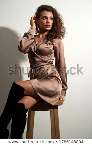 Jovem morena preto perneiras isolado Foto stock © acidgrey