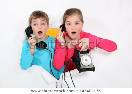 Brother and sister using old telephone Stock photo © photography33
