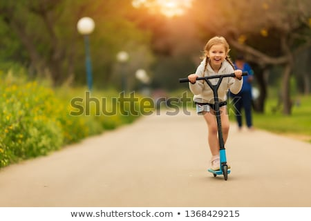 little girl with a scooter stock photo © phbcz