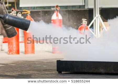 Piros szén tűzoltó készülék közelkép Stock fotó © wavebreak_media