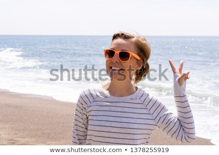 Carefree woman relaxing on a sunny breezy day Stock photo © photography33